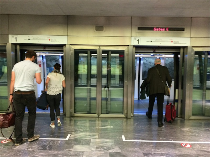 trams in zurich airport with silver sliding doors