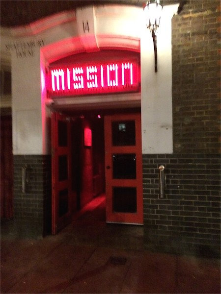 Door way with Mission written above in red lights