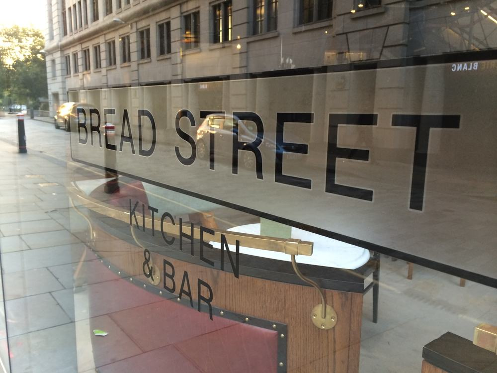 glass window with bread street written on it in black