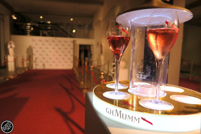 Champagne glass with red carpet